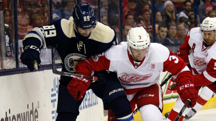 Columbus Blue Jackets forward Sam Gagner, left, works against Detroit Red Wings defenseman Nick Jensen during the second period of an NHL hockey game in Columbus, Ohio, Saturday, Feb. 11, 2017. (AP Photo/Paul Vernon)