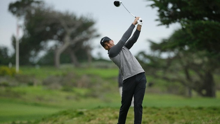 Jason Day, of Australia, hits from the 17th tee of the Monterey Peninsula Country Club Shore Course during the first round of the AT&T Pebble Beach National Pro-Am golf tournament Thursday, Feb. 9, 2017, in Pebble Beach, Calif. (AP Photo/Eric Risberg)