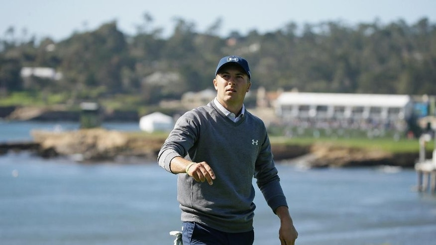Jordan Spieth looks over the fifth green of the Pebble Beach Golf Links during the third round of the AT&T Pebble Beach National Pro-Am golf tournament Saturday, Feb. 11, 2017, in Pebble Beach, Calif. (AP Photo/Eric Risberg)