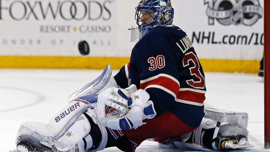 New York Rangers goalie Henrik Lundqvist (30) makes a save during the third period of an NHL hockey game against the Colorado Avalanche Saturday, Feb. 11, 2017, in New York. (AP Photo/Adam Hunger)
