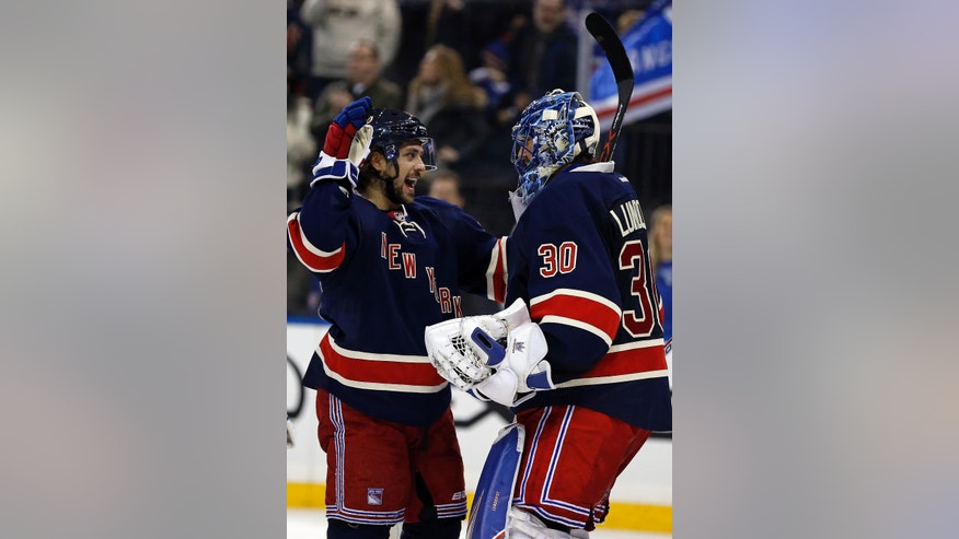 New York Rangers right wing Mats Zuccarello, left, congratulates Rangers goalie Henrik Lundqvist (30) on his 400th career win after defeating the Colorado Avalanche in an NHL hockey game Saturday, Feb. 11, 2017, in New York. (AP Photo/Adam Hunger)
