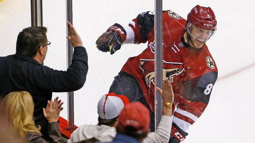 Arizona Coyotes right wing Tobias Rieder celebrates his goal against the Pittsburgh Penguins during the second period of an NHL hockey game, Saturday, Feb. 11, 2017, in Glendale, Ariz. (AP Photo/Ross D. Franklin)