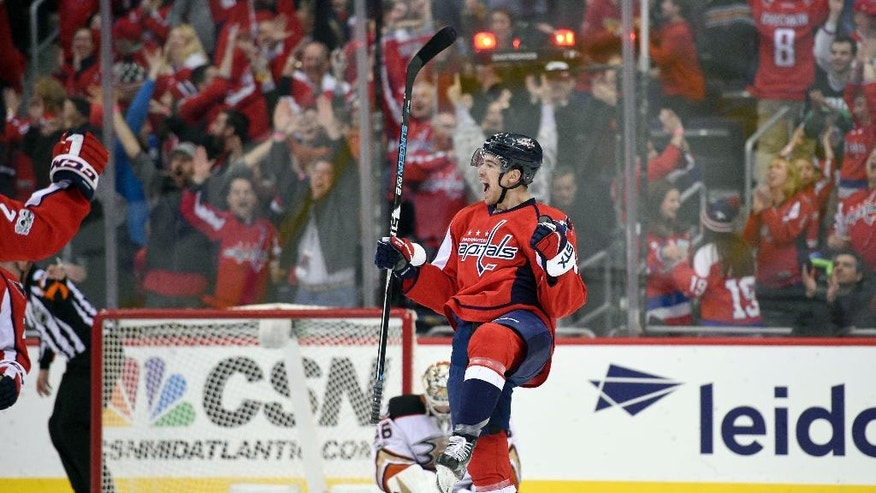Washington Capitals center Zach Sanford celebrates his goal during the third period of an NHL hockey game as Anaheim Ducks goalie John Gibson, back, looks on Saturday, Feb. 11, 2017, in Washington. It was Sanford's first NHL goal. (AP Photo/Nick Wass)