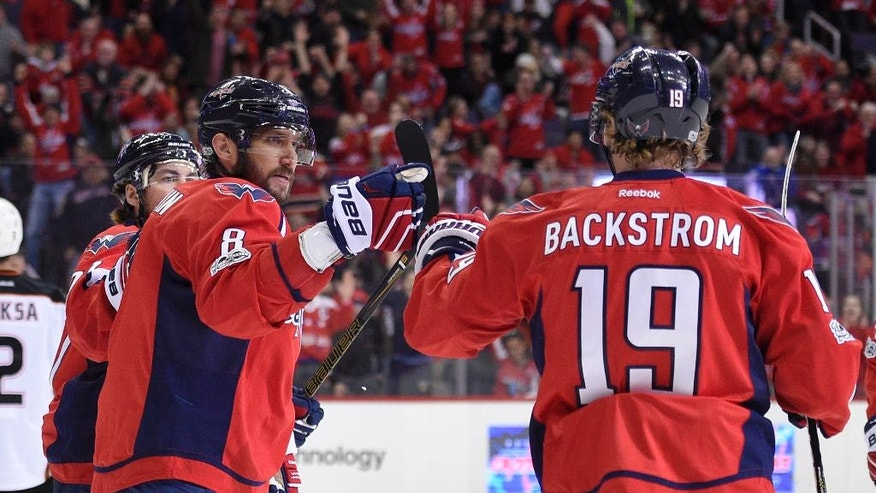 Washington Capitals center Nicklas Backstrom (19), of Sweden, celebrates his goal with Alex Ovechkin (8), of Russia, during the first period of an NHL hockey game against the Anaheim Ducks, Saturday, Feb. 11, 2017, in Washington. (AP Photo/Nick Wass)