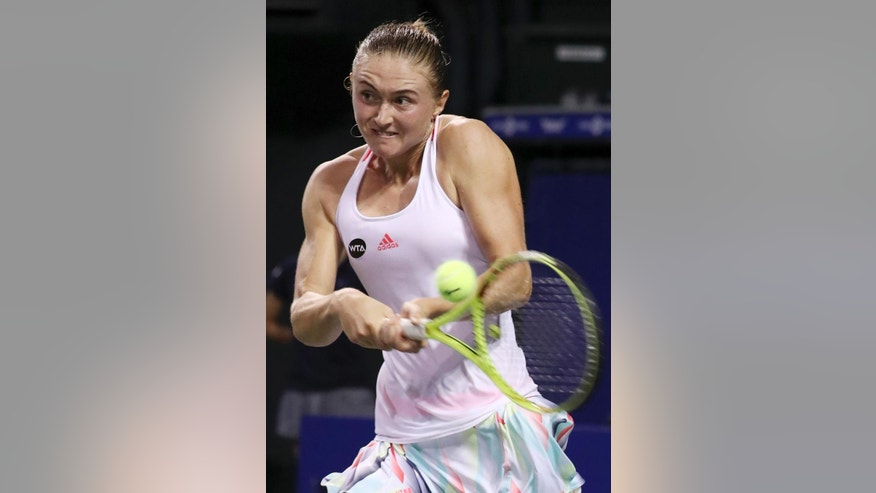 FILE In this file photo taken on Thursday, Sept. 22, 2016, Aliaksandra Sasnovich, of Belarus, returns a shot against Karolina Pliskova, of the Czech Republic, during the women's singles match at the Pan Pacific Open women's tennis tournament in Tokyo, Japan. Sasnovich is ranked 104 places below Dutch world No. 24 Kiki Bertens, but didn't let it show as she broke Bertens' serve seven times in a 6-3, 6-4 win, Sunday, Feb. 12, 2017. (AP Photo/Eugene Hoshiko, file)