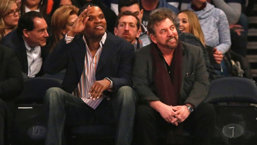 Feb 12, 2017; New York, NY, USA; Latrell Sprewell waves sitting next to New York Knicks executive chairman James L. Dolan during the first quarter against the San Antonio Spurs at Madison Square Garden. Mandatory Credit: Adam Hunger-USA TODAY Sports