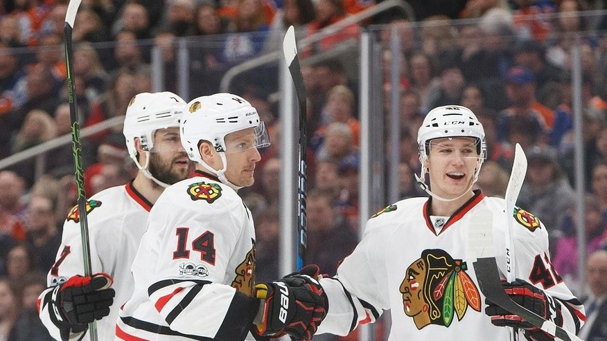 Chicago Blackhawks defenseman Brent Seabrook (7), left wing Richard Panik (14) and defenseman Gustav Forsling (42) celebrate a goal goal against the Edmonton Oilers during the first period of an NHL hockey game Saturday, Feb. 11, 2017, in Edmonton, Alberta. (Jason Franson/The Canadian Press via AP)