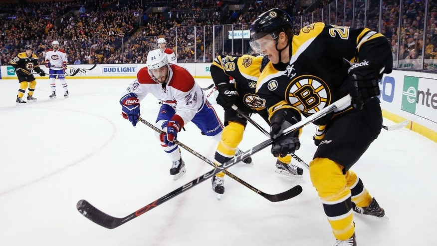 Boston Bruins' Riley Nash (20) and Montreal Canadiens' Phillip Danault (24) battle for the puck during the second period of an NHL hockey game in Boston, Sunday, Feb. 12, 2017. (AP Photo/Michael Dwyer)