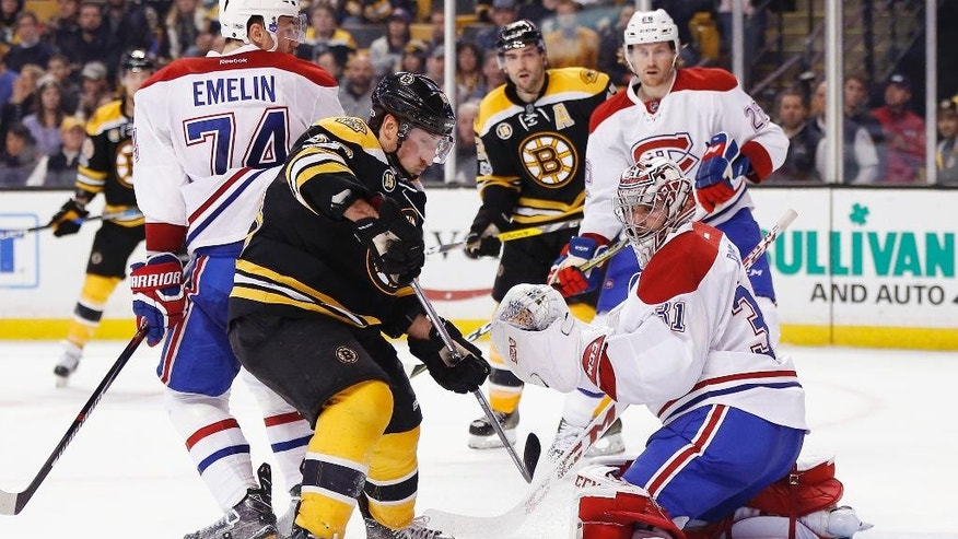 Boston Bruins' Brad Marchand, foreground left, looks for the rebound off Montreal Canadiens' Carey Price (31) during the second period of an NHL hockey game in Boston, Sunday, Feb. 12, 2017. (AP Photo/Michael Dwyer)