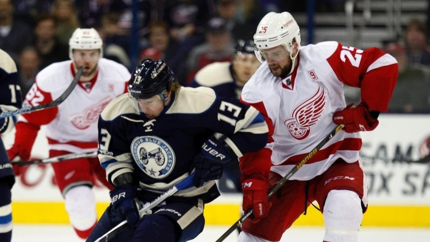 Columbus Blue Jackets forward Cam Atkinson, left, works against Detroit Red Wings defenseman Mike Green during the second period of an NHL hockey game in Columbus, Ohio, Saturday, Feb. 11, 2017. (AP Photo/Paul Vernon)