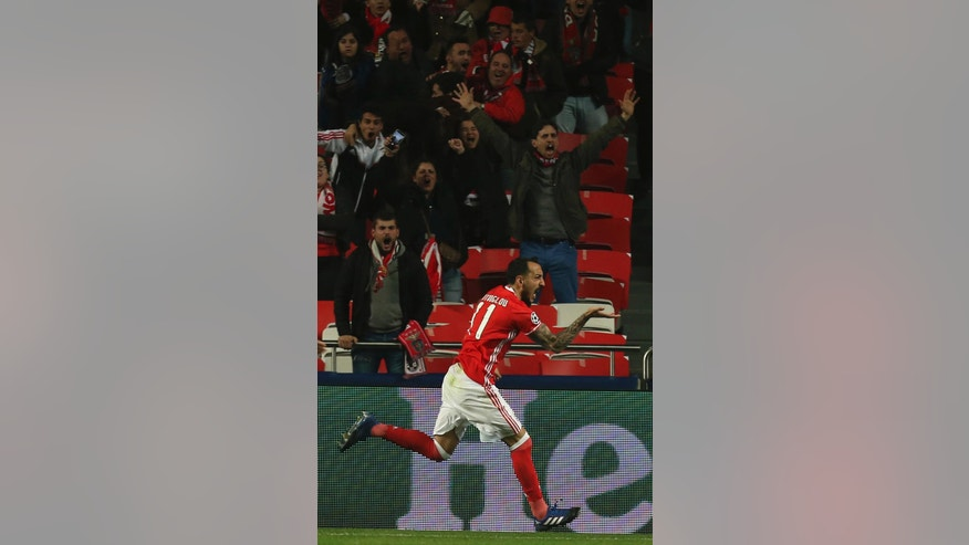 Benfica's Kostas Mitroglou celebrates scoring the opening goal during the Champions League round of 16, first leg, soccer match between Benfica and Borussia Dortmund at the Luz stadium in Lisbon, Tuesday, Feb. 14, 2017. (AP Photo/Armando Franca)