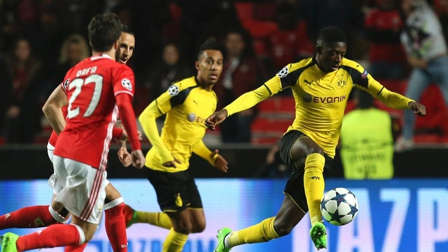 Dortmund's Ousmane Dembele fights for the ball during the Champions League round of 16, first leg, soccer match between Benfica and Borussia Dortmund at the Luz stadium in Lisbon, Tuesday, Feb. 14, 2017. (AP Photo/Armando Franca)
