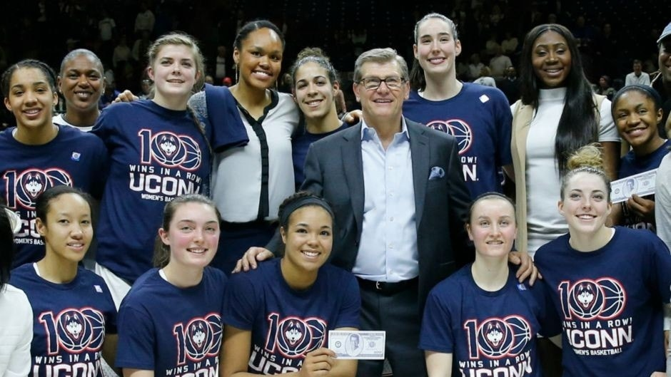 Feb 13, 2017; Storrs, CT, USA; The Connecticut Huskies and alumni celebrate their 100th win against the South Carolina Gamecocks at Harry A. Gampel Pavilion. UConn defeated South Carolina 66-55. Mandatory Credit: David Butler II-USA TODAY Sports