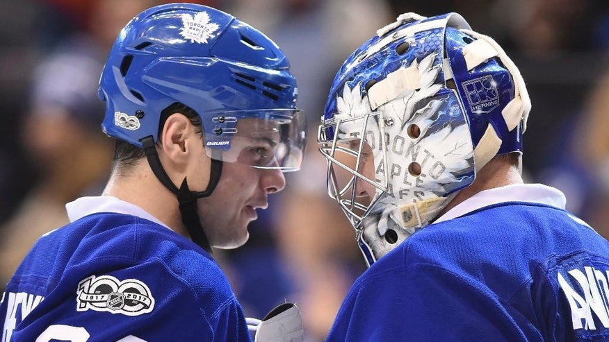 Toronto Maple Leafs centre Auston Matthews (34) and goalie Frederik Andersen (31) congratulate each other after their win over the New York Islanders following NHL hockey action in Toronto on Tuesday, Feb. 14, 2017. (Frank Gunn/The Canadian Press via AP)