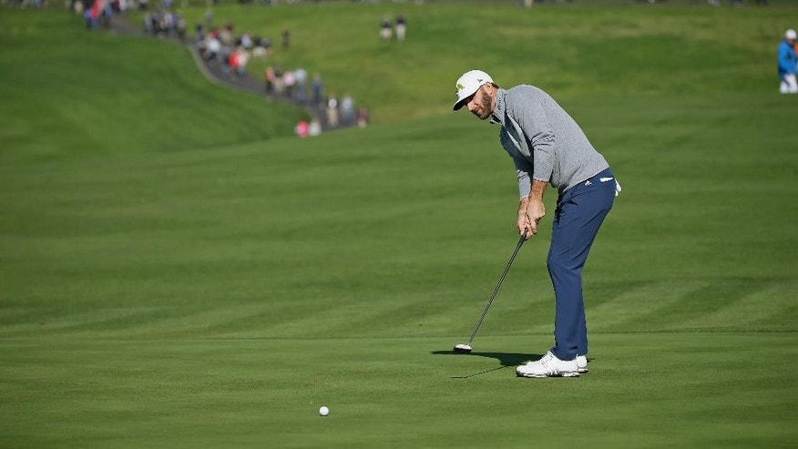 Dustin Johnson putts on the sixth green of the Pebble Beach Golf Links during the third round of the AT&T Pebble Beach National Pro-Am golf tournament Saturday, Feb. 11, 2017, in Pebble Beach, Calif. (AP Photo/Eric Risberg)