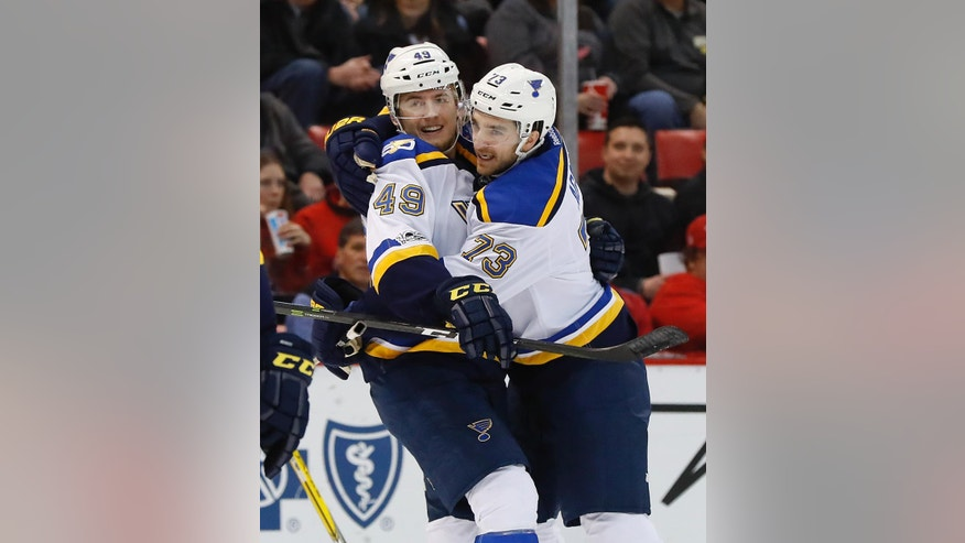 St. Louis Blues center Ivan Barbashev (49) celebrates his goal against the Detroit Red Wings with Kenny Agostino (73)in the first period of an NHL hockey game, Wednesday, Feb. 15, 2017, in Detroit. (AP Photo/Paul Sancya)