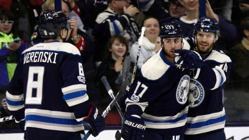 Columbus Blue Jackets forward Boone Jenner, right, celebrates his goal against the Toronto Maple Leafs with teammates defenseman Zach Werenski, left, and forward Brandon Dubinsky during the first period of an NHL hockey game in Columbus, Ohio, Wednesday, Feb. 15, 2017. The BLue Jackets won 5-2. (AP Photo/Paul Vernon)
