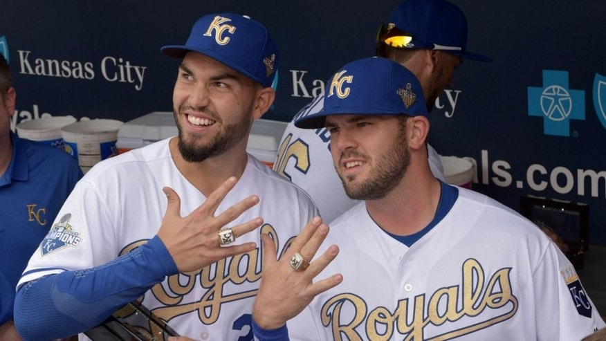 Apr 5, 2016; Kansas City, MO, USA; Kansas City Royals first baseman Eric Hosmer (35) and third baseman Mike Moustakas (8) show off their World Series rings before the game against the New York Mets at Kauffman Stadium. Mandatory Credit: Denny Medley-USA TODAY Sports