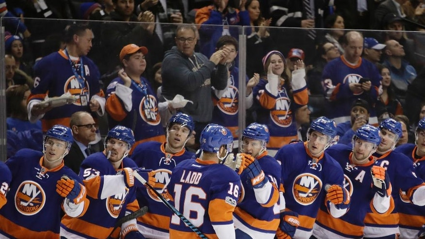 New York Islanders' Andrew Ladd (16) celebrates with teammates after scoring a goal during the second period of the team's NHL hockey game against the New York Rangers Thursday, Feb. 16, 2017, in New York. (AP Photo/Frank Franklin II)