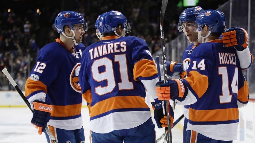 New York Islanders' Anders Lee celebrates his goal with teammates Thomas Hickey (14), John Tavares (91) and Josh Bailey (12) during the second period of an NHL hockey game against the New York Rangers Thursday, Feb. 16, 2017, in New York. (AP Photo/Frank Franklin II)