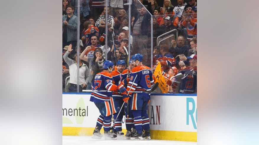 Edmonton Oilers celebrate a goal against the Philadelphia Flyers during the third period of an NHL hockey game Thursday, Feb. 16, 2017, in Edmonton, Alberta, (Jason Franson/The Canadian Press via AP)