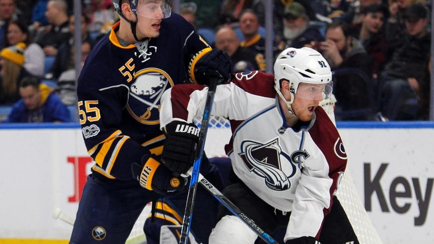 Buffalo Sabres' Rasmus Ristolainen (55) and Colorado Avalanche's Gabriel Landeskog (92) battle for position during the second period of an NHL hockey game, Thursday, Feb. 16, 2017, in Buffalo, N.Y. (AP Photo/Jeffrey T. Barnes)