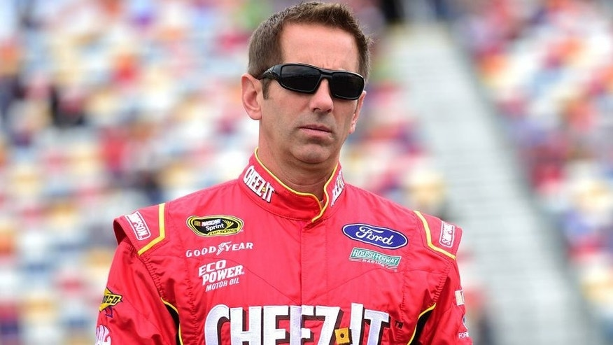 CHARLOTTE, NC - MAY 21: Greg Biffle, driver of the #16 Cheez-It Ford, walks on the grid prior to the NASCAR Sprint Cup Series Sprint Showdown at Charlotte Motor Speedway on May 21, 2016 in Charlotte, North Carolina. (Photo by Jared C. Tilton/Getty Images)