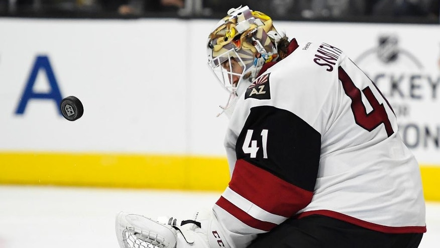 Arizona Coyotes goalie Mike Smith stops a shot during the second period of the team's NHL hockey game against the Los Angeles Kings, Thursday, Feb. 16, 2017, in Los Angeles. (AP Photo/Mark J. Terrill)