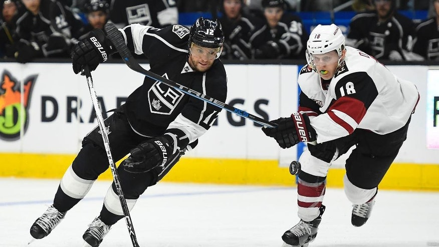 Los Angeles Kings right wing Marian Gaborik, of Slovakia, and Arizona Coyotes center Christian Dvorak vie for the puck during the second period of an NHL hockey game, Thursday, Feb. 16, 2017, in Los Angeles. (AP Photo/Mark J. Terrill)
