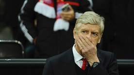 Arsenal's manager Arsene Wenger covers his face prior to the first leg of the Champions League round of 16 soccer match between Bayern Munich and FC Arsenal in the Allianz Arena in Munich, Germany, Wednesday, Feb. 15 , 2017. (Sven Hoppe/dpa via AP)
