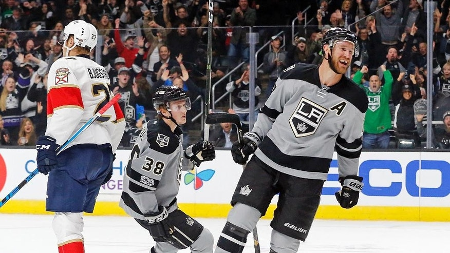 Los Angeles Kings left winger Tanner Pearson, right, celebrates his goal and defenseman Paul LaDue (38) his assist against, during the second period against the Florida Panthers in an NHL hockey game in Los Angeles Saturday, Feb. 18, 2017. (AP Photo/Reed Saxon)