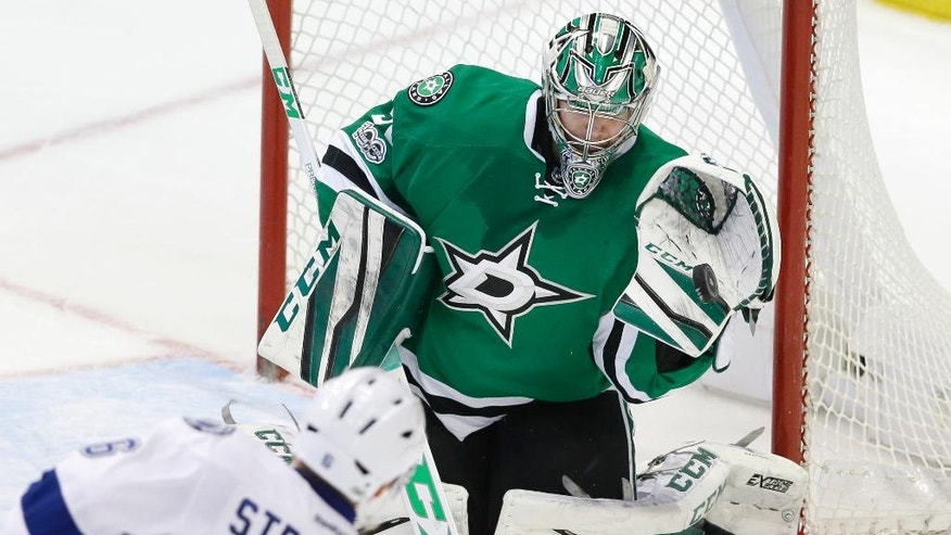 Dallas Stars goalie Kari Lehtonen (32) blocks a shot by Tampa Bay Lightning defenseman Anton Stralman (6) during the third period of an NHL hockey game in Dallas, Saturday, Feb. 18, 2017. The Stars won 4-3 in overtime. (AP Photo/LM Otero)