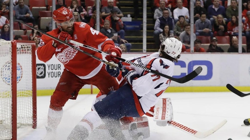 Detroit Red Wings left wing Henrik Zetterberg (40) checks Washington Capitals right wing T.J. Oshie (77) during the first period of an NHL hockey game, Saturday, Feb. 18, 2017, in Detroit. (AP Photo/Carlos Osorio)
