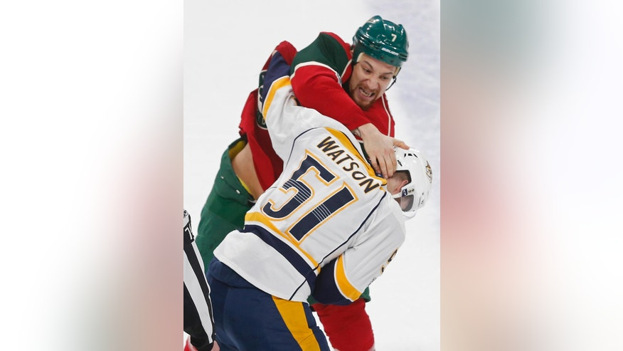 Minnesota Wild's Chris Stewart, top, and Nashville Predators' Austin Watson fight during the first period of an NHL hockey game, Saturday, Feb. 18, 2017, in St. Paul, Minn. (AP Photo/Jim Mone)