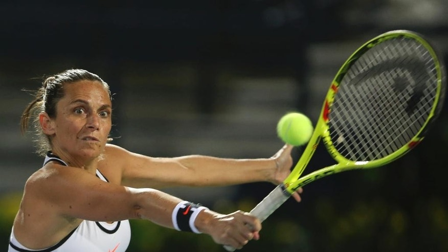 Roberta Vinci of Italy returns the ball to Kristyna Pliskova of Czech Republic during the Dubai Tennis Championships, in Dubai, United Arab Emirates, Sunday, Feb. 19, 2017. (AP Photo/Kamran Jebreili)