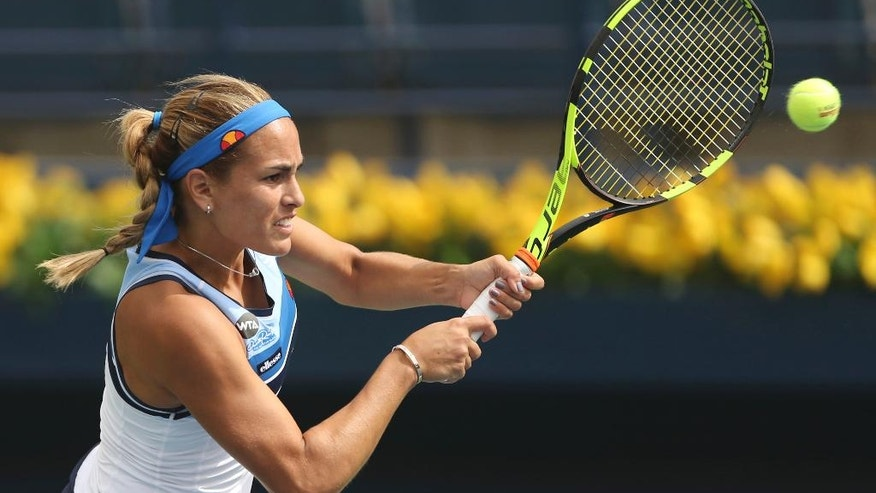 Monica Puig of Portugal returns the ball to Yaroslavl Shvedova of Kazakistan during the Dubai Tennis Championships in Dubai, United Arab Emirates, Monday, Feb. 20, 2017. (AP Photo/Kamran Jebreili)