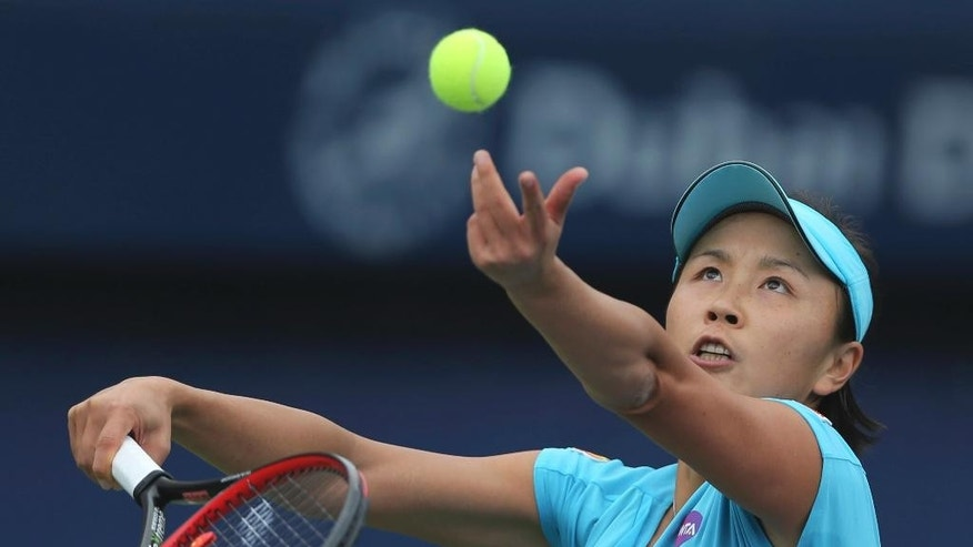 Shuai Peng of China serves the ball to Lesia Tsurenko of Ukraine during the Dubai Tennis Championships in Dubai, United Arab Emirates, Monday, Feb. 20, 2017. (AP Photo/Kamran Jebreili)