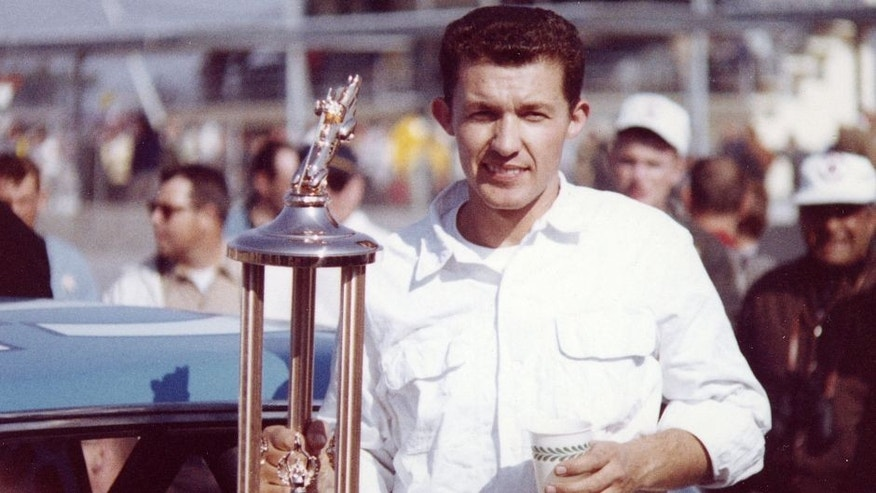 DAYTONA BEACH, FL — February 23, 1964: Richard Petty holds his trophy in victory lane at Daytona International Speedway after winning the Daytona 500 NASCAR Cup race. Petty and his new hemi-engined Plymouth dominated the event leading 184 of the 200 laps. (Photo by ISC Images & Archives via Getty Images)