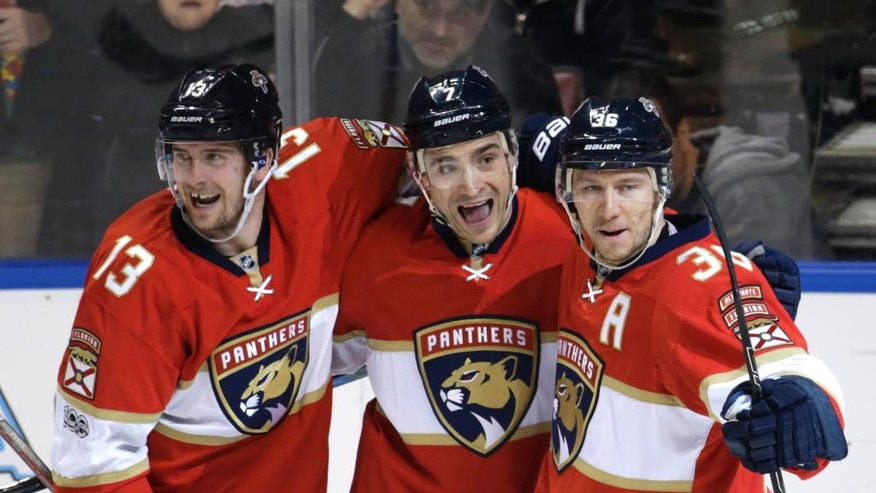 Florida Panthers center Colton Sceviour (7) celebrates with defenseman Mark Pysyk (13) and left wing Jussi Jokinen (36) after scoring a goal against the Edmonton Oilers during the second period of an NHL hockey game, Wednesday, Feb. 22, 2017, in Sunrise, Fla. (AP Photo/Lynne Sladky)
