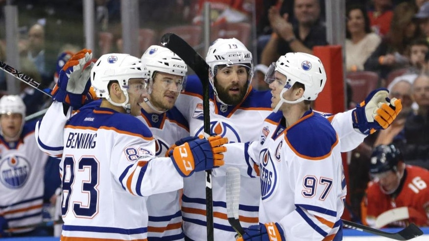 Edmonton Oilers defenseman Oscar Klefbom, second from left, celebrates with Matt Benning (83), Patrick Maroon (19) and Connor McDavid (97) after scoring a goal during the first period against the Florida Panthers during an NHL hockey game, Wednesday, Feb. 22, 2017, in Sunrise, Fla. (AP Photo/Lynne Sladky)