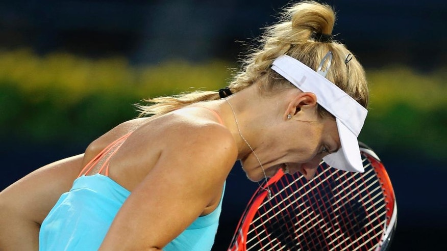 Angelique Kerber of Germany celebrates after she scoring a point against Monica Puig of Puerto Rico, during the Dubai Tennis Championships, in Dubai, United Arab Emirates, Wednesday, Feb. 22, 2017. (AP Photo/Kamran Jebreili)