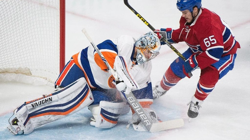 Montreal Canadiens' Andrew Shaw moves in on New York Islanders goalie Thomas Greiss during the first period of an NHL hockey game Thursday, Feb. 23, 2017, in Montreal. (Graham Hughes/The Canadian Press via AP)