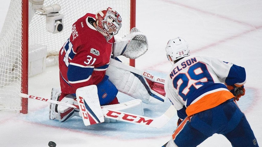 Montreal Canadiens goaltender Carey Price makes a save against New York Islanders' Brock Nelson during the second period of an NHL hockey game Thursday, Feb. 23, 2017, in Montreal. (Graham Hughes/The Canadian Press via AP)