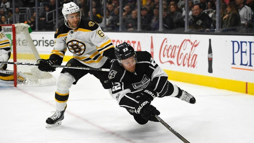 Los Angeles Kings center Trevor Lewis, right, falls as he tries to pass the puck while under pressure from Boston Bruins defenseman Colin Miller during the second period of an NHL hockey game, Thursday, Feb. 23, 2017, in Los Angeles. (AP Photo/Mark J. Terrill)