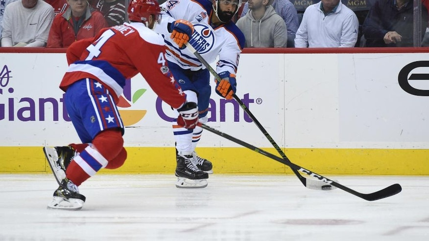Edmonton Oilers left wing Jujhar Khaira (54) is pressured by Washington Capitals defenseman Taylor Chorney (4) during the first period of an NHL hockey game, Friday, Feb. 24, 2017, in Washington. (AP Photo/Molly Riley)