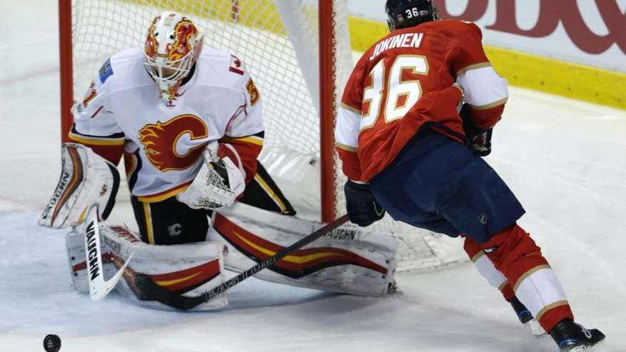 Calgary Flames goalie Chad Johnson (31) stops a shot by Florida Panthers left wing Jussi Jokinen (36) during the second period of an NHL hockey game, Friday, Feb. 24, 2017, in Sunrise, Fla. (AP Photo/Lynne Sladky)