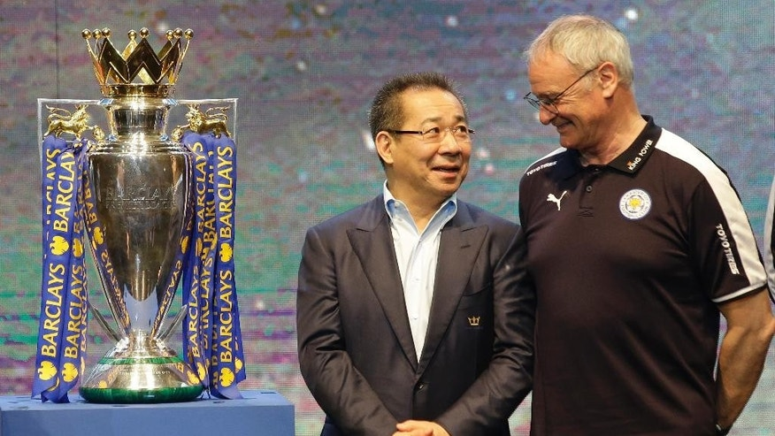 FILE - In this Wednesday, May 18, 2016 file photoLeicester City's chairman Vichai Srivaddhanaprabha, left, talks to Leicester City's Manager Claudio Ranieri beside the English Premier League soccer champions trophy during a press conference in Bangkok, Thailand. Leicester City announced Thursday, Feb. 23, 2017 that they have sacked manager Claudio Ranieri less than a year after their incredible run to the Premier League title. (AP Photo/Sakchai Lalit, File)