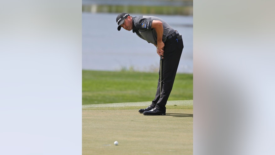 Ryan Palmer reacts to his putt on the ninth hole during the second round of the Honda Classic golf tournament, Friday, Feb. 24, 2017, in Palm Beach Gardens, Fla. (AP Photo/Wilfredo Lee)