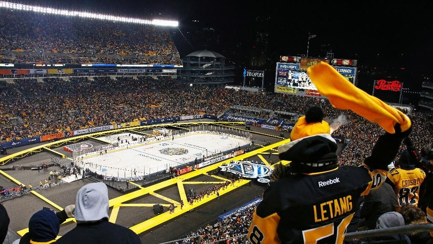 The Pittsburgh Penguins are introduced before an NHL Stadium Series hockey game at Heinz Field against the Philadelphia Flyers in Pittsburgh, Saturday, Feb. 25, 2017. (AP Photo/Gene J. Puskar)