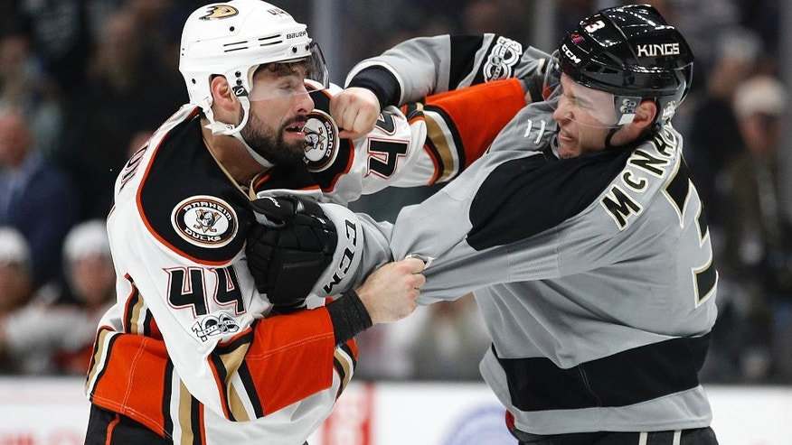 Anaheim Ducks' Nate Thompson, left, fights with Los Angeles Kings' Brayden McNabb during the second period of an NHL hockey game Saturday, Feb. 25, 2017, in Los Angeles. (AP Photo/Jae C. Hong)